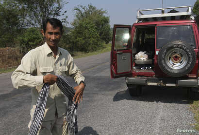 Chut Wutty, Director of the Natural Resource Protection Group, walks in Koh Kong province, Feb. 20, 2012. Chut Wutty, a prominent Cambodian anti-logging activist who helped expose a secretive state sell-off of national parks, was fatally shot on Apri...