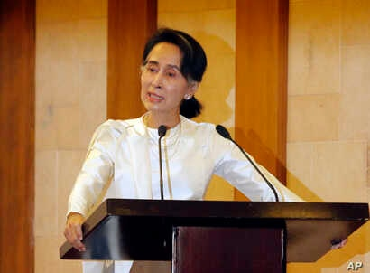 Myanmar State Counsellor Aung San Suu Kyi speaks at a memorial ceremony to mark one month from the killing of Ko Ni, prominent legal adviser to the government, and taxi driver Ne Win, Feb.26, 2017, in Yangon, Myanmar.