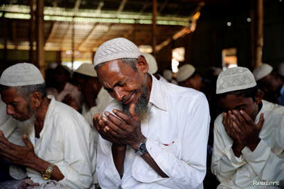 A Rohingya refugee cries during Eid al-Adha prayer in Kutupalong refugee camp in Cox's Bazar, Bangladesh, Aug. 22, 2018.
