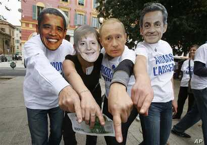 Anti-globalization members wearing masks, from left, of US President Barack Obama, German Chancellor Angela Merkel, Vladimir Putin Prime Minister of Russia  and French President Nicolas Sarkozy demonstrate in Nice, southeastern France, against G20 su...