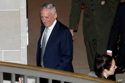 Defense Secretary Jim Mattis leaves a closed door meeting that he attended with Secretary of State Mike Pompeo and Senators about Saudi Arabia, Nov. 28, 2018, on Capitol Hill in Washington.