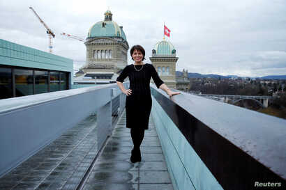 Swiss President and Minister of Environment, Transport, Energy and Communications, Doris Leuthard, 54, poses for a photograph on top of a roof next the Swiss Parliament in Bern, Switzerland, Feb. 24, 2017.