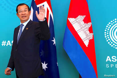 Cambodia's Prime Minister Hun Sen reacts to a journalist's question as he walks with Australian Prime Minister Malcolm Turnbull before the start of their bilateral meeting during the one-off summit of 10-member Association of Southeast Asian Nations ...
