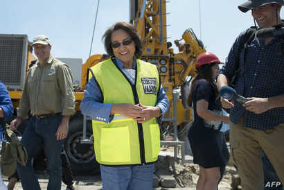 Cape Town City Mayor Patricia de Lille talks at a site where the city council has ordered drilling into the aquifer to tap water in Mitchells Plain, about 25km from the city center on January 11, 2018 in Cape Town.