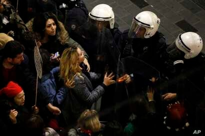 A protester reacts as Turkish police block Istiklal, the main shopping street, in Istanbul, during International Women's Day, March 8, 2019.