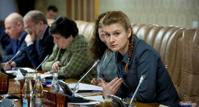 FILE - Public figure Maria Butina (R) attends a meeting of a group of experts, affiliated to the government of Russia, in this undated handout photo obtained by Reuters on July 17, 2018.