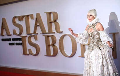 "Actress and singer Lady Gaga poses for photographers upon arrival at the premiere of the film ""A Star Is Born"" in London, Sept. 27, 2018."
