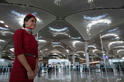 An airline employee stands in Istanbul's new airport ahead of its opening, Oct. 29, 2018.