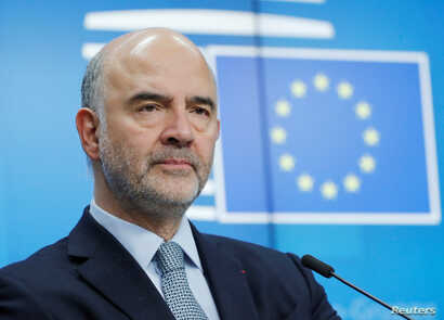 FILE - European Commissioner for Economic and Financial Affairs Pierre Moscovici attends a news conference at the end of a eurozone finance ministers meeting in Brussels, Belgium, Dec. 4, 2018.