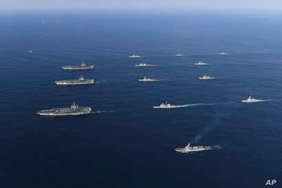 Three U.S. aircraft carriers USS Nimitz, left top, USS Ronald Reagan, left center, and USS Theodore Roosevelt, left bottom, participate with other U.S. and South Korean navy ships during the joint naval exercises between the United States and South K...