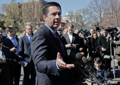 House Intelligence Committee Chairman Rep. Devin Nunes, R-Calif, speaks with reporters outside the White House in Washington, March 22, 2017, following a meeting with President Donald Trump.