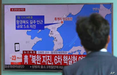 A man watches a TV news report about a possible nuclear test conducted by North Korea at the Seoul Railway  station in Seoul, South Korea, Sept. 3, 2017.