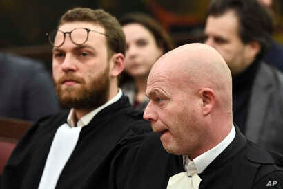 Belgian lawyer Sven Mary, right, and lawyer Romain Delcoigne, left, attend the trial of Salah Abdeslam at the Brussels Justice Palace in Brussels on Monday, Feb. 5, 2018.
