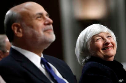 Federal Reserve Chair Janet Yellen, right, and former Federal Reserve Chair Ben Bernanke smile during introductions at a ceremony awarding them both with the Paul H. Douglas Award for Ethics in Government on Capitol Hill in Washington, Nov. 7, 2017. ...