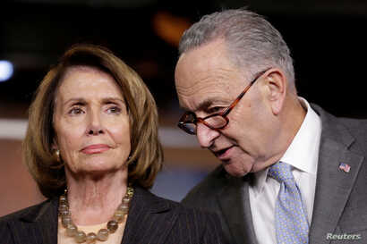 FILE - House Minority Leader Nancy Pelosi (D-California), left, and Senate Minority Leader Chuck Schumer (D-New York) speak during a briefing on Capitol Hill in Washington, Nov. 2, 2017.