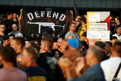 "People demonstrate on Aug. 27, 2018 in Chemnitz, eastern Germany, following the death of a 35-year-old German national who died in hospital after a ""dispute between several people of different nationalities,"" according to the police."