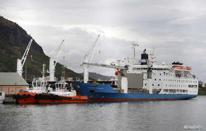 FILE - View of the harbor of Port Louis on the Indian Ocean island of Mauritius, Aug. 5, 2015.