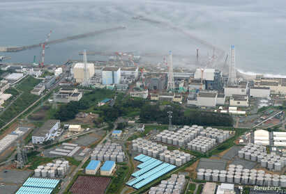 An aerial view shows the tsunami-crippled Fukushima Daiichi nuclear power plant and its contaminated water storage tanks in this photo taken by Kyodo, August 20, 2013.