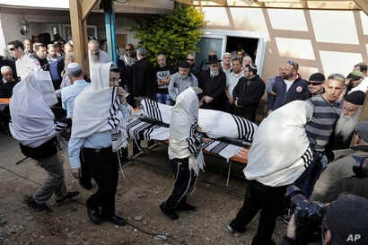 Israelis carry the body of Raziel Shevah during his funeral in Havat Gilad, an unauthorized Israeli settlement outpost near the Palestinian city of Nablus, Jan. 10, 2018. Shevah, an Israeli settler, was killed in a drive-by shooting that occurred Tue...
