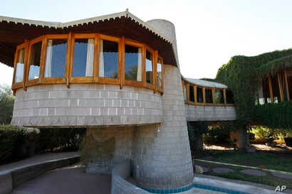FILE - This Oct. 19 2012 file photo shows a home that architect Frank Lloyd Wright designed for his son in Phoenix, Arizona.