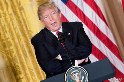 FILE - U.S. President Donald Trump attends a press conference at the White House in Washington, Jan. 10, 2018.