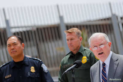 U.S. Attorney General Jeff Sessions holds a news conference next to the U.S. Mexico border wall to discuss immigration enforcement actions of the Trump Administration near San Diego, California, May 7, 2018.