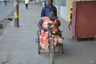 Fanny Banda-- on the wheelchair, says begging is a humiliating experinace but she still has to beg anyway because of poverty.