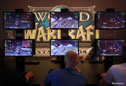 FILE - Visitors play ''World of Warcraft'' at an exhibition stand during the Gamescom 2012 fair in Cologne.