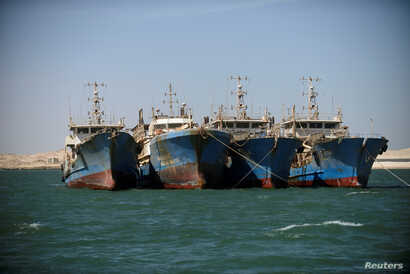 Chinese fishing vessels are seen moored off the coast of Nouadhibou, Mauritania, April 14, 2018.