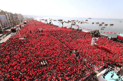 FILE - Turkish President Recep Tayyip Erdogan greets AK Party and Nationalist Movement Party (MHP) supporters during a rally for the upcoming local elections, in Izmir, Turkey, March 17, 2019.