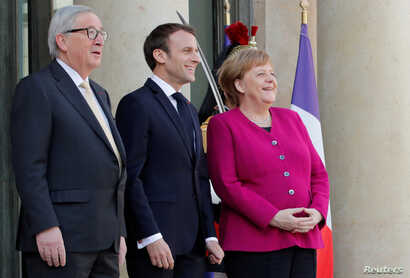 French President Emmanuel Macron, German Chancellor Angela Merkel and European Commission President Jean-Claude Juncker welcome Chinese President Xi Jinping, not pictured, at the Elysee Palace in Paris, March 26, 2019.