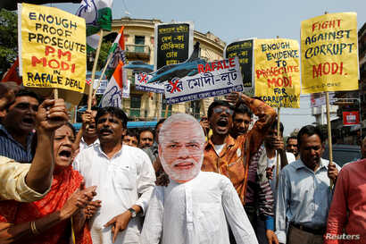 Supporters of India's main opposition Congress shout slogans against Prime Minister Narendra Modi during a protest over allegations of corruption in a Rafale fighter planes deal with France, in Kolkata, India, March 7, 2019.