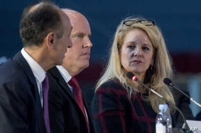 From left, Sierra Nevada Corporation CEO Fatih Ozman, Blue Origin CEO Bob Smith and SpaceX President and CEO Gwynne Shotwell appear as panelists at the first meeting of the National Space Council at the Steven F. Udvar-Hazy Center in Chantilly, Va., ...