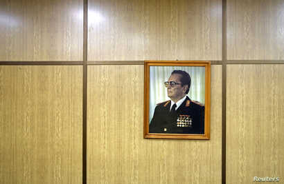 FILE - A portrait of Josip Broz Tito is seen in his underground secret bunker in Konjic, Bosnia and Hercegovina, Oct. 16, 2014.