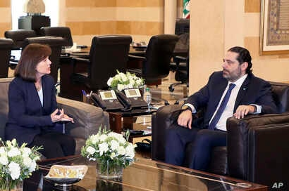 FILE - United States Ambassador to Lebanon Elizabeth Richard, left, speaks with Lebanese Prime Minister Saad Hariri, at the government House, in Beirut, Feb 19, 2019. Richard has expressed her country's concerns over the growing role of the militant ...