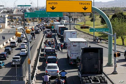 Cars and trucks line up to enter Mexico from the U.S. at a border crossing in El Paso, Texas,  March 29, 2019.