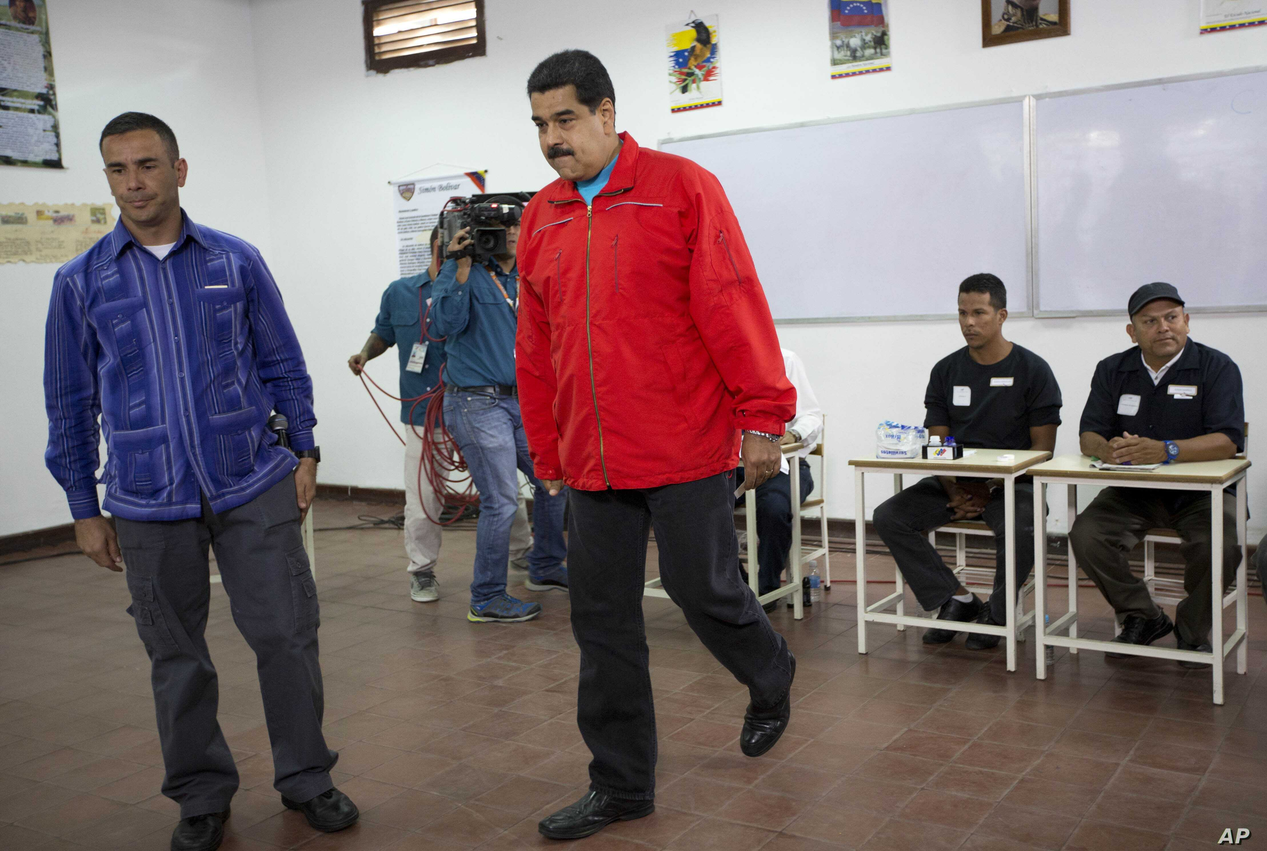 Venezuela's President Nicolas Maduro arrives at a polling station to vote during congressional elections in Caracas, Venezuela, Sunday, Dec. 6, 2015.