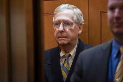 Senate Majority Leader Mitch McConnell, R-Ky., arrives at the Capitol in Washington, Jan. 19, 2018, as a bitterly-divided Congress hurtles toward a government shutdown this weekend.