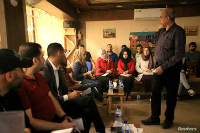 Students of journalism gather at training workshop for Iraqi journalists at Qantara Culture Cafe in Mosul, Oct. 26, 2018.