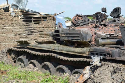 Tanks that have been destroyed during fighting between forces of Salva Kiir and Riek Machar, on July 10, 2016 in Jabel area of Juba, South Sudan, Saturday, July 16, 2016.