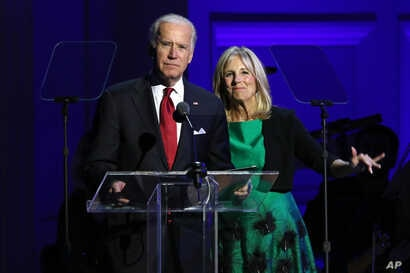 """FILE - Vice President Joe Biden, left, and Jill Biden speak at """"It Always Seems Impossible Until It Is Done: A Night of Music with ONE and (RED)"""", in celebration of World AIDS Day, at Carnegie Hall."""