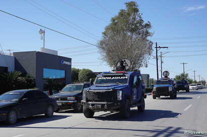 State police armoured vehicles patrol at an industrial park where employees from some plants are on strike in Matamoros, state of Tamaulipas, Mexico, Jan. 29, 2019.