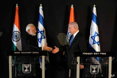 Indian Prime Minister Narendra Modi, left, shakes hands with Israeli Prime Minister Benjamin Netanyahu during their meeting at the King David hotel in Jerusalem, July 5, 2017.