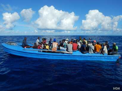 84 Haitian migrants on a 42-foot vessel approximately 30 miles southwest of Turks and Caicos Islands, Oct. 28, 2018. While on routine patrol the cutter Thetis crew located the migrant vessel and embarked all 84 migrants for repatriation to Port-au-Pr...