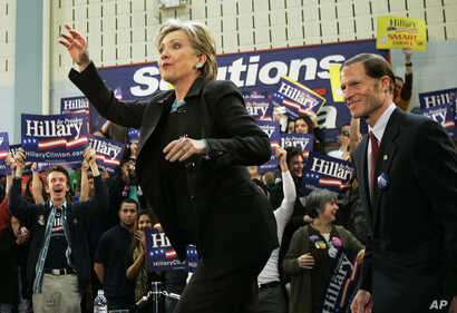 FILE - Then-Democratic presidential hopeful, Sen. Hillary Rodham Clinton, D-N.Y., waves while taking the stage with then-Connecticut Atty. Gen. Richard Blumenthal during a rally in Hartford, Connecticut, Jan. 28, 2008.