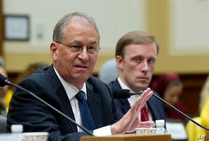 President of the Institute for Science and International Security David Albright, left, accompanied by Former State Department Director of Policy Planning Jake Sullivan speaks before the House Foreign Affairs Committee at Capitol Hill in Washington, ...