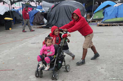 FILE - Migrant children from Nicaragua, part of a caravan of thousands from Central America tying to reach the United States, play at a temporary shelter in Tijuana, Mexico, Jan. 18, 2019.