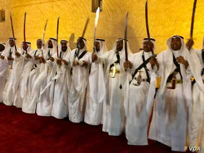 Saudi men, dressed in traditional garb and holding long swords aloft, perform a traditional war victory dance of the Nadj region. President Donald Trump and first lady Melania Trump walked past them into a small museum on the grounds of Murabba Palac...