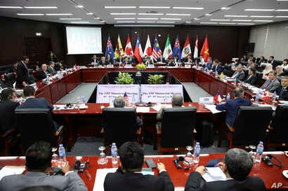 FILE - Trade ministers and delegates from the remaining members of the Trans Pacific Partnership (TPP) attend the TPP ministerial meeting on the sidelines of the Asia-Pacific Economic Cooperation (APEC) leaders summit, Nov. 9, 2017 in Danang, Vietnam...
