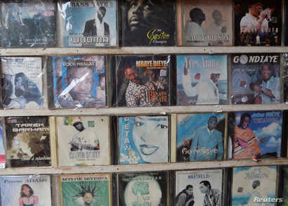 CDs for sale are displayed at a street market in Dakar, Senegal, Aug. 22, 2017.